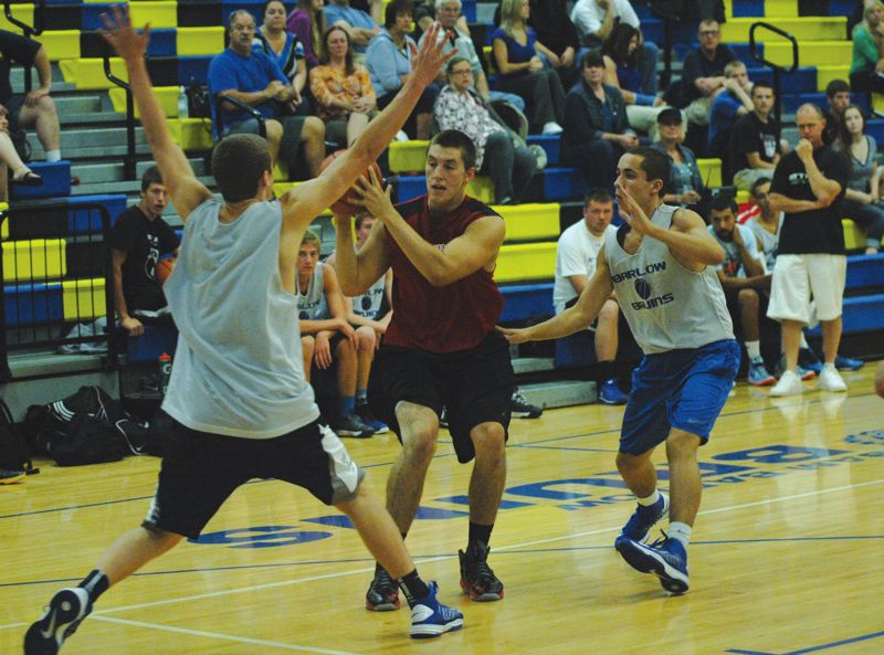 by: SANDY POST: PARKER LEE - Sandys Austin Gorski finds his way to the basket through the middle of Barlows defense.