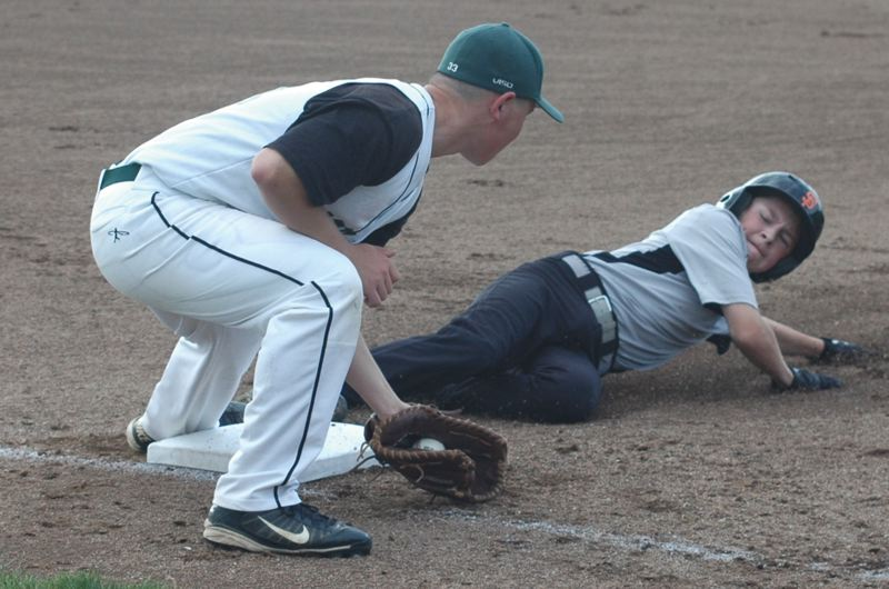 by: ESTACADA NEWS: PARKER LEE - Estacadas Orion Alexander lays down a tag at first base.