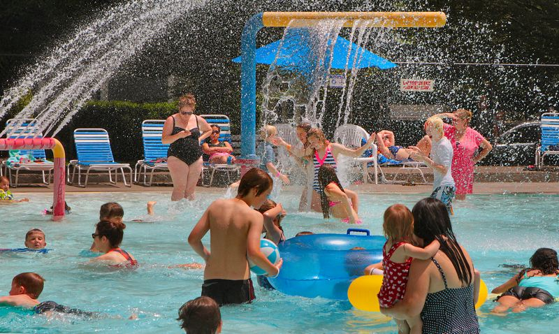 by: DAVID F. ASHTON - The Sellwood Pools Big Shower is a fun water feature - especially on a hot day.