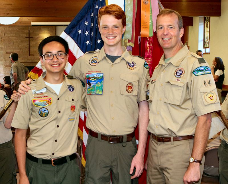 by: DAVID F. ASHTON - Boy Scouts of America Troop 64 members Caleb Walcott and Zachary Armstrong are joined their Scoutmaster, Tom Gustafson, as they are honored for achieving the rank of Eagle Scout.