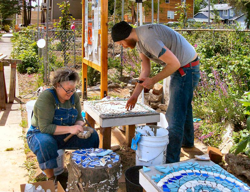 by: RITA A. LEONARD - Kailash residents Martha Shepherd and Matthew Hammond create mosaic tables for the public patio in the neighborhood project in Creston-Kenilworth.