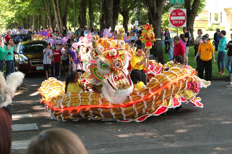 by: DAVID F. ASHTON - This big beast, brought to the parade by Northwest Dragon & Lion Dance Association, curls up as it chases the Pearl of Wisdom.