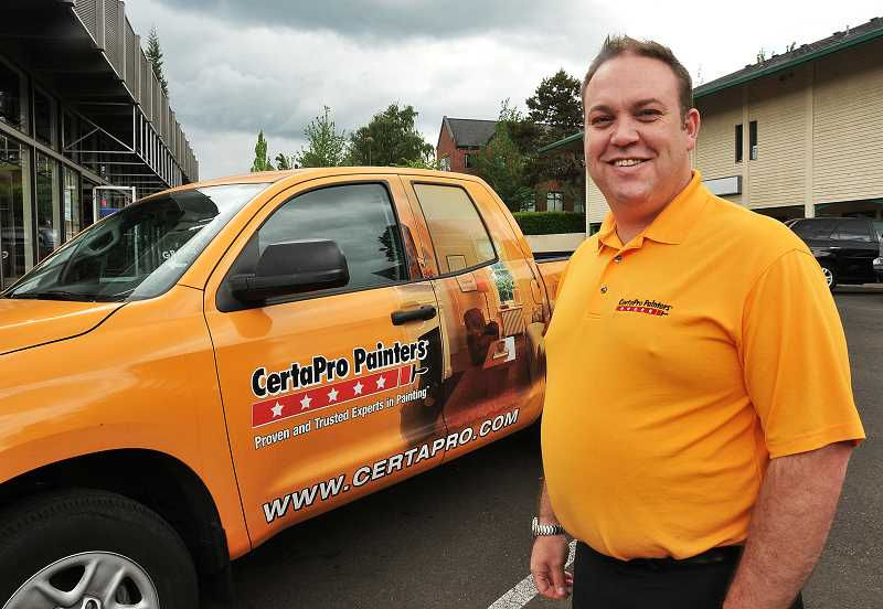 by: REVIEW PHOTO: VERN UYETAKE - Dan and his van. Dan Molyneuxs spiffy van is a good advertisement for his CertaPro franchise. His reliability is an even better advertisement.