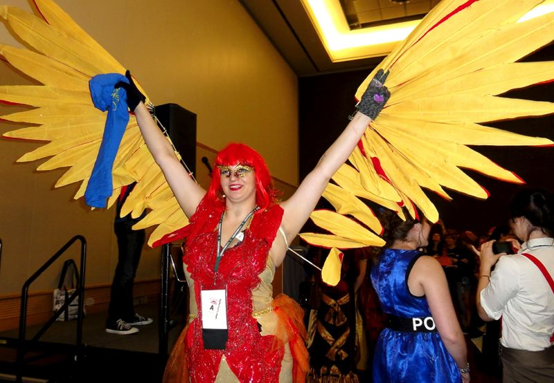 by: COURTESY OF HELENA GALLIVAN - Kari O'Sullivan of Seattle shows off her Fawkes the Phoenix costume at Portland's LeakyCon gathering last week at the Oregon Convention Center.