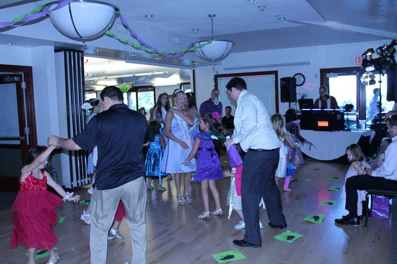 by: SUBMITTED PHOTO - Princess Celia Lawrence shares the dance flooor with dads and their daughters.