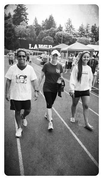 by: SUBMITTED PHOTO - Mike Hasson is shown walking with Lynae Forbes and his daughter, Jenna, at the 2012 Relay for Life event in Lake Oswego. This year he will not only be walking but speaking.