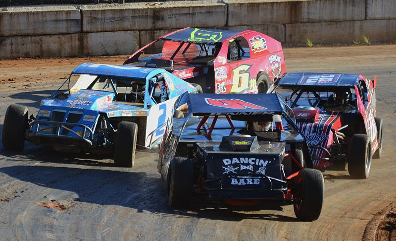 by: JOHN BREWINGTON - Robert Jenner of Vancouver leads the Trophy Dash race Saturday at River City Speedway in St. Helens. He won the Modified Division race, was second in a heat, and fifth in the main event.