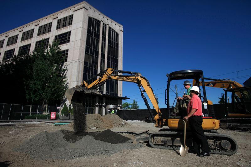 by: TIMES PHOTO: JONATHAN HOUSE - Beaverton Mayor Denny Doyle tried his hand at the backhoe machine on Friday morning at a groundbreaking ceremony for the South Plaza at The Round at Beaverton Central.
