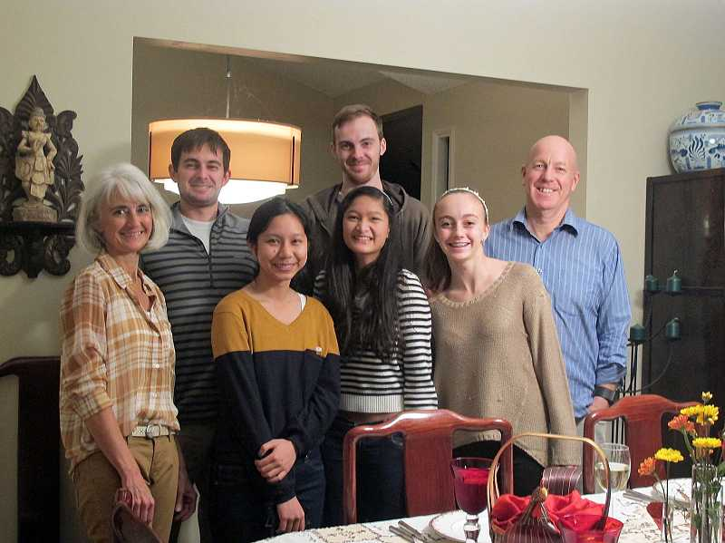 by: SUBMITTED PHOTO: SARA FLORES - The Sayre family and exchange student Panny Nopmaneepaisan enjoyed Thanksgiving together last year, from left: back row: Mitchell, Eric, Rich; front row: Lisa, Nopmaneepaisan, Maddie, Eva.