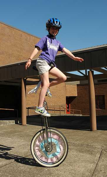 by: REVIEW PHOTO: VERN UYETAKE - Pauline Petersen shows off her unicycling skills.