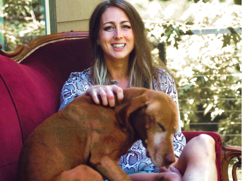 by: GRESHAM OUTLOOK: DAVID BALL - Corbett High graduate Kaitlin Wilson, a three-time 2A Player of the Year, spends time on the back deck with the family dog Copper.