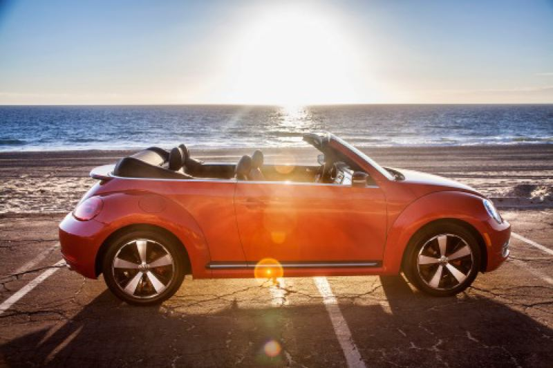 by: VOLKSWAGEN OF AMERICA - The 2013 VW Beetle TDI Convertible has fun saving the world.