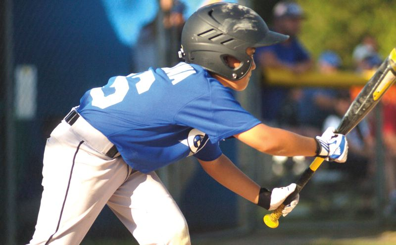 by: GRESHAM OUTLOOK: DAVID BALL - Greshams Kai Kiyokawa turns to bunt during Fridays 6-5 championship win over Reynolds.