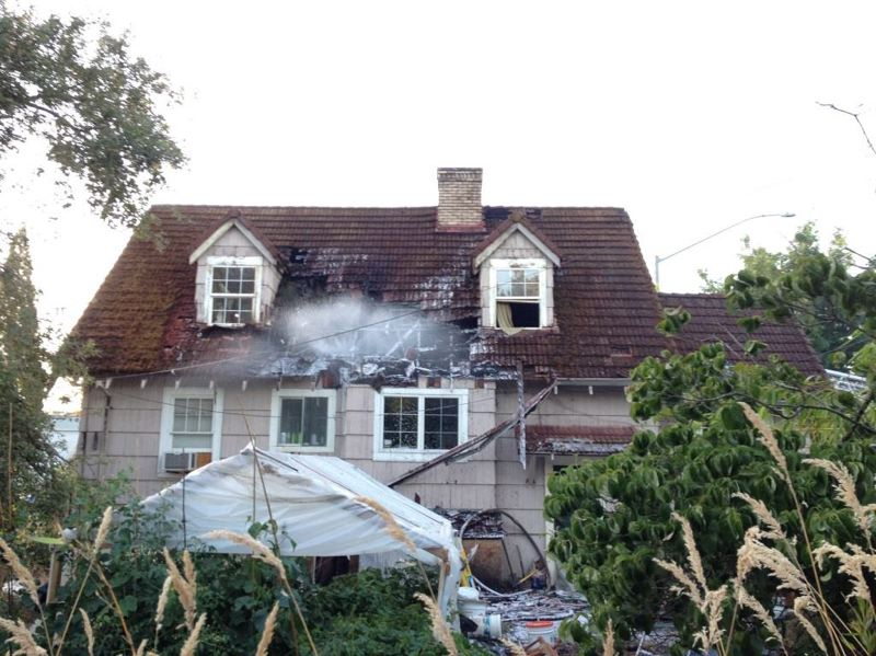 by: TUALATIN VALLEY FIRE & RESCUE - A fire on Sunday evening caused major damage to this two-story home in the 16000 block of Southwest Farmington Road.