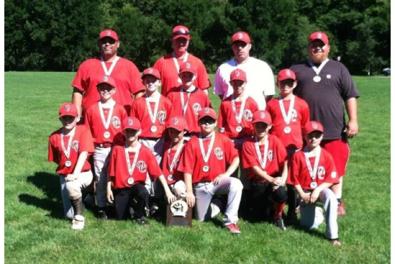 by: SUBMITTED - The Oregon City Red Rascals have a lot to be proud of. They played their best baseball of the season at the 2013 Clackamas County Junior Baseball Midget American Championship Tournament, and won the third-place team trophy. Vying for the Rascals were: (first row, left to right) Robert Ashby, Weston Bean, Dylan Ha, Harley Richter, Dominik Neff and Rylan Williams; (second row) Blake Anderson, Owen McCrae, Camden Fowler, Timothy Hyne and Justin Caldwell; (back) head coach Jason Stewart, coach Mike Fowler, coach Travis Stewart and coach Michael Richter; and (not pictured) Ashton Meeker.