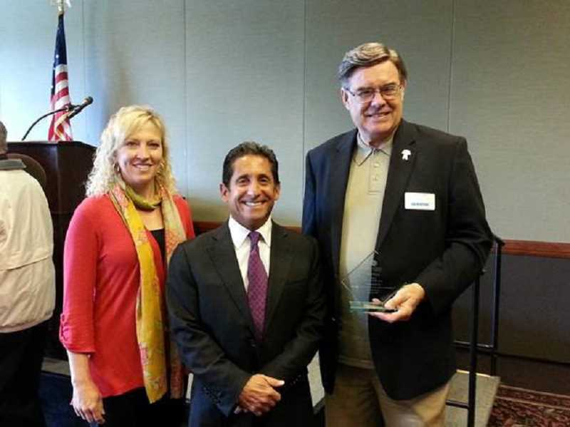 by: SUBMITTED PHOTO - Bob Ulery, at right, a Realtor with the Hasson Company was recently named the 2013 Broker of the Year by the Portland Metropolitan Association of Realtors Million Dollar Club. With him are Lynae Forbes, Hasson Companys vice president of Oregon operations and Mike Hasson, company president.