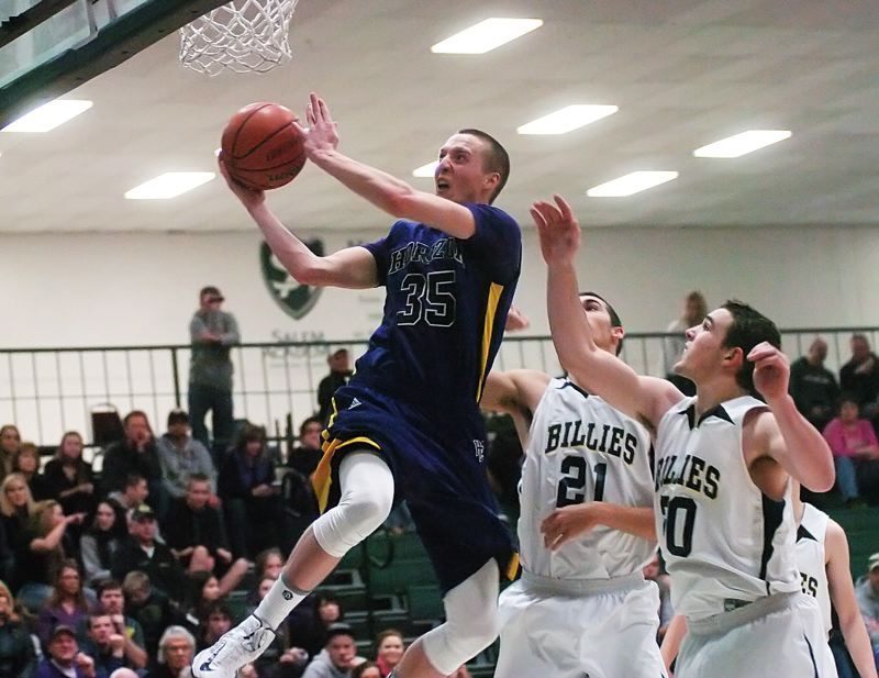by: DAN BROOD - FLOATING ON AIR -- Calvin Anderson (35) goes up to the basket during the Hawks' game with Pleasant Hill.