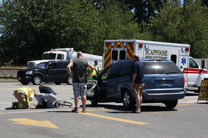by: SPOTLIGHT PHOTO: ROBIN JOHNSON - The biker was riding westbound on the sidewalk of Highway 30 in Scappoose when the driver of a Dodge Caravan pulled out of the Dairy Queen parking lot to make a right turn and crashed into him.