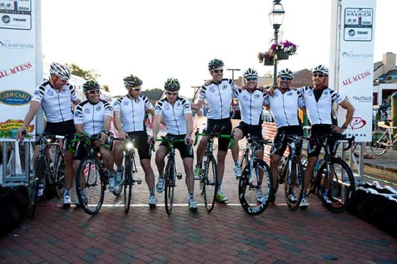 by: VIC ARMIJO - All members of the Allied Forces team pose together at the finish of the 2,998-mile Race Across America in Annapolis, Md.