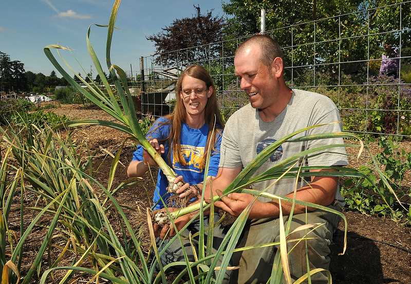 by: VERN UYETAKE - Brice and Amber Anderson keep busy at Luscher Farm growing lots of vegetables for the Lake Oswego Adult Community Center.