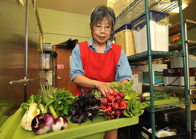 by: VERN UYETAKE - Julynne Pang is always excited on Friday mornings when she sees the huge haul of fresh vegetables from Luscher Farm.