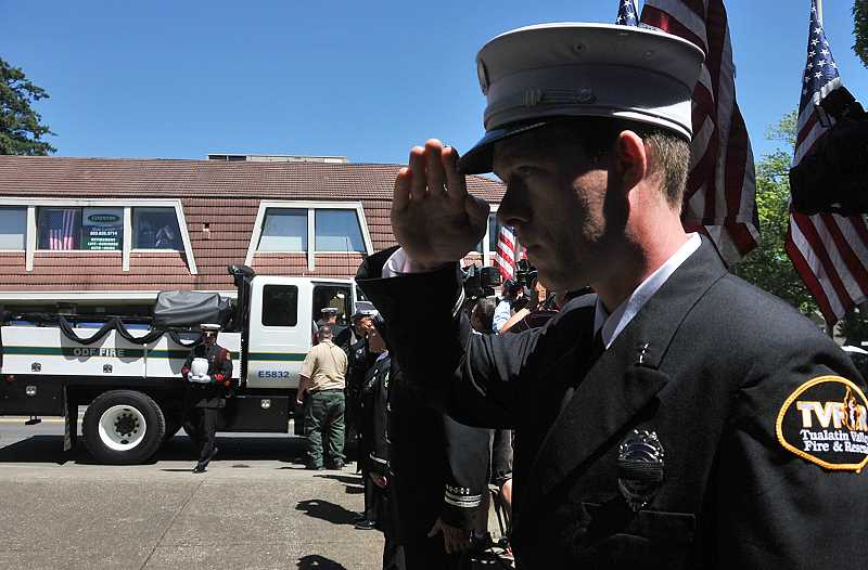 by: VERN UYETAKE - Emergency responders participating in the procession paid their respect to West Linn fallen firefighter John J. Percin Jr. Wishing to keep the focus on Percin, participants declined to give their names.