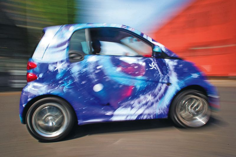by: TRIBUNE PHOTO: CHRISTOPHER ONSTOTT - Mercedes-Benz launched its Smart Fortwo electric car in Portland in May. The city is becoming a testing ground for alternative fuel vehicles.