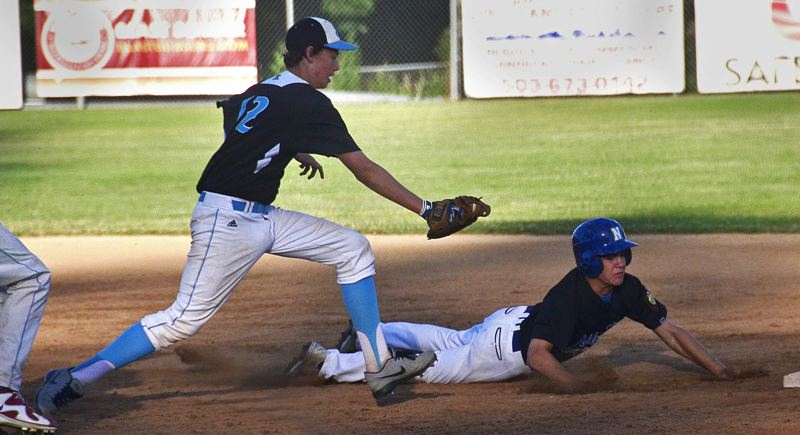 by: VERN UYETAKE - Michael Sheldon looks to make a tag in the team's game against Newberg.