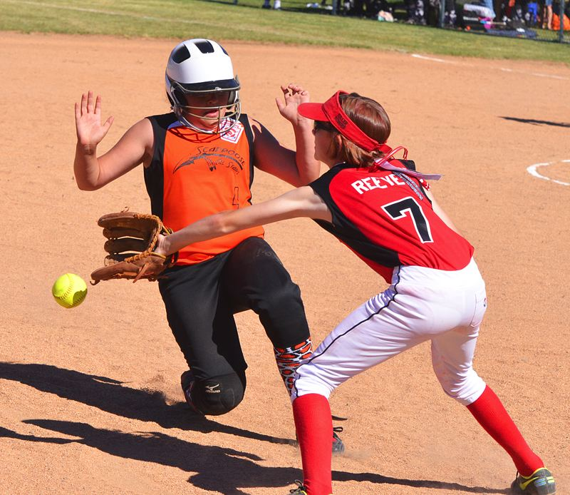 by: JOHN BREWINGTON - Haylee Dorie slips into third during the Scappoose 10-11 game against Hollywood/Rose City/Wilshire-Riverside last week. The team will play at state at the Centennial Middle School field in Gresham.