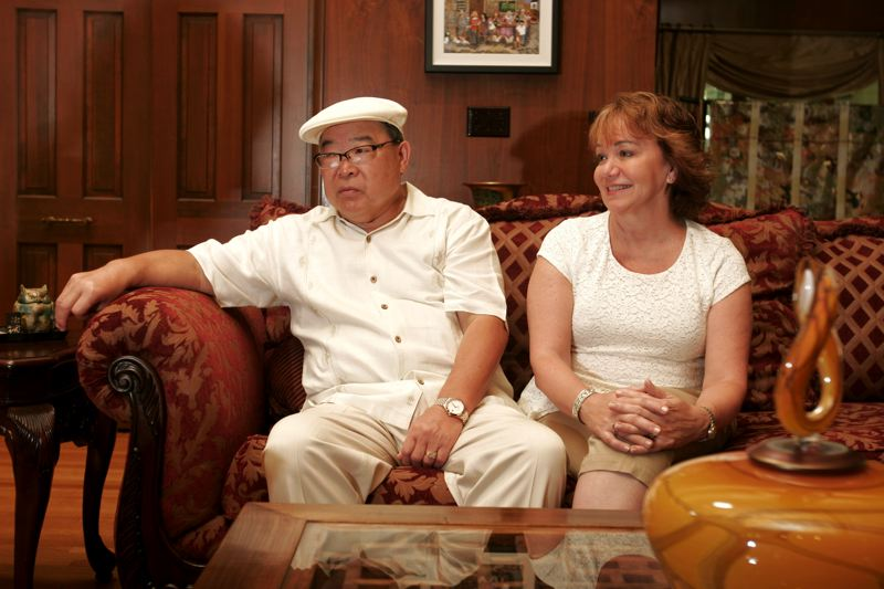 by: OUTLOOK PHOTO: JIM CLARK - A jet-lagged Junki Yoshida and his wife, Linda, sit inside their home in Troutdale.