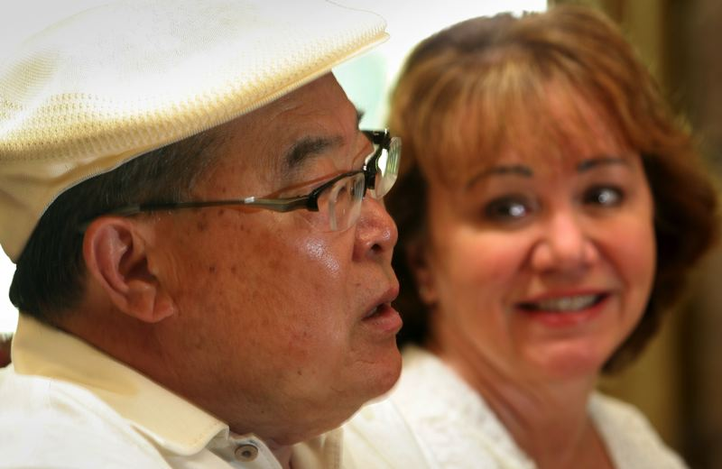 by: OUTLOOK PHOTO: JIM CLARK - Creater of Yoshida Gourmet (teriyaki) Sauce, Junki Yoshida,64, and his wife Linda.