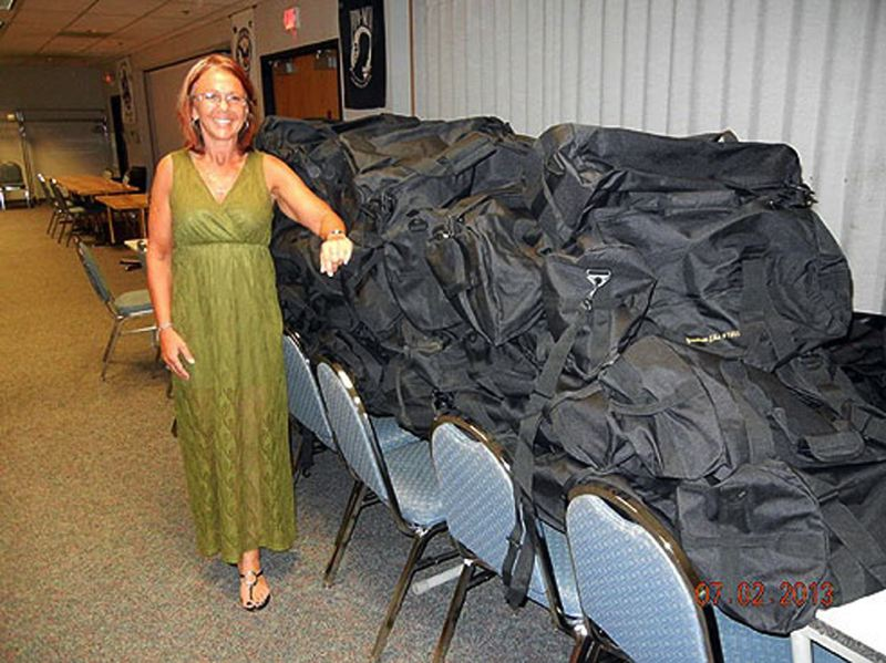 by: CONTRIBUTED PHOTO: BETTY CHISUM - Elks leader Malia Bafford displays the 75 bags going to homeless vets Tuesday, July 2.