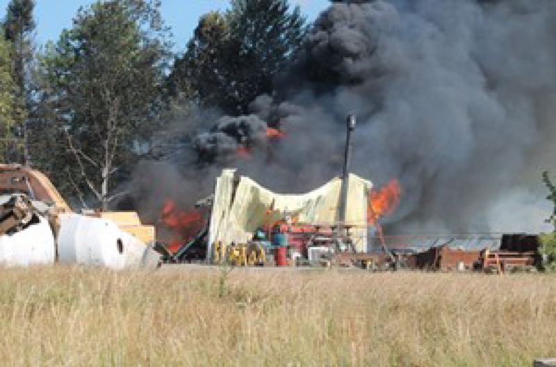 by: MOLALLA PIONEER: CORY MIMMS - Firefighters from Clackamas County, Molalla and surrounding cities battled at least two barn fires Friday afternoon. The fires also damaged a cement plant.