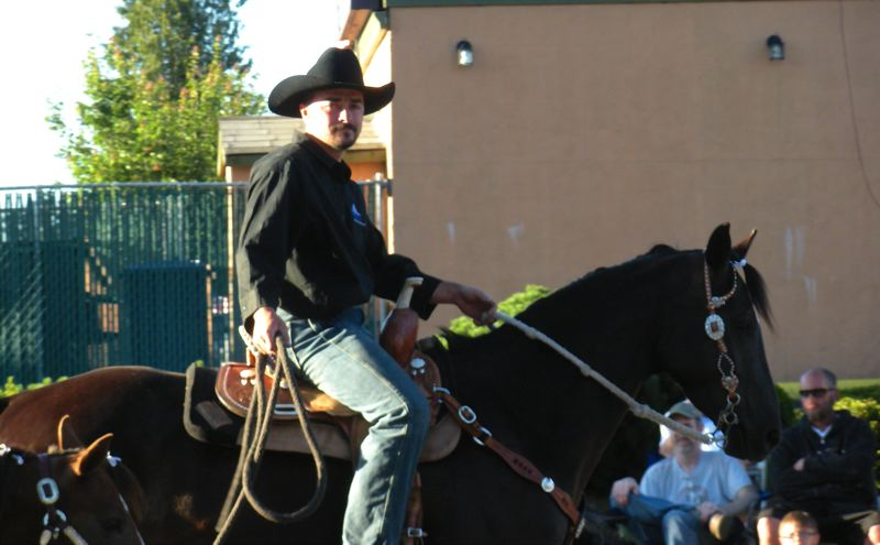 by: POST PHOTO: JIM HART - One rider - part of the three-or-more equestrian entry from Mt. Hood Hospice - saunters along Pioneer Boulevard last Thursday during the Sandy Mountain Festival Parade. Mt. Hood Hospice was the winner of the Florence Schmidt Memorial Award.