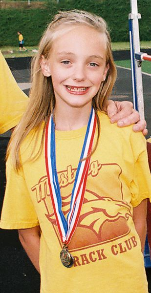 by: JOHN DENNY - High jump champion ISABELLA VAUGHN