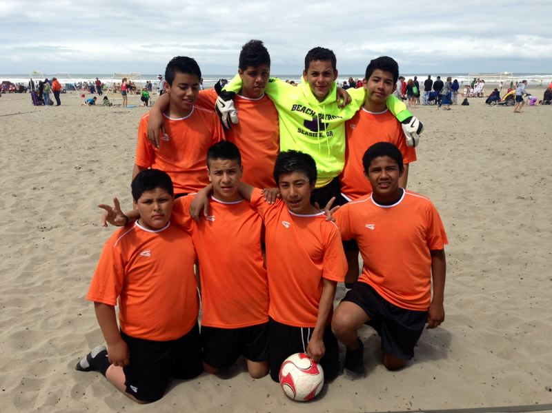 by: SUBMITTED - The players on Rowe Middle Schools Todos Juntos soccer team did themselves and their community proud at the recent Seaside Tournament of Champions beach soccer tournament, going undefeated and claiming the championship in their division. Vying for the standout team were: (first row, from left) Gustavo Felix, Jesus Olmos, Brian Miguel and Richard Campos; and (back) Gerardo Chavez, Carlos Pereira, Juan Gudino and Louis Bernal. Juan Maldonado coached the team, with assistance from Joe Goodley.