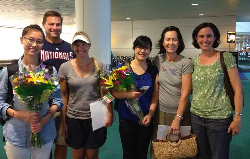 by: SUBMITTED - Two Chinese teachers arrived in Portland on Sept. 8 for the 2012-13 school year. From left, Yang Lei and her hosts, Matt and Wendy Miller, and Gu Zhe with her host, Denise Jones, and Sunset Principal Lisa Hawking.