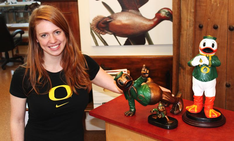 by: OUTLOOK PHOTO: CARI HACHMANN - Alison Brown, 24, and her bronze-casted Ducks.