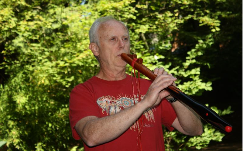by: POST PHOTO: JIM HART - Native American style flute player Randal Veenker loves to hear the haunting sound of a flute in a natural setting. Veenker will show a film about the flute, show examples and play a mini concert Saturday, July 20.