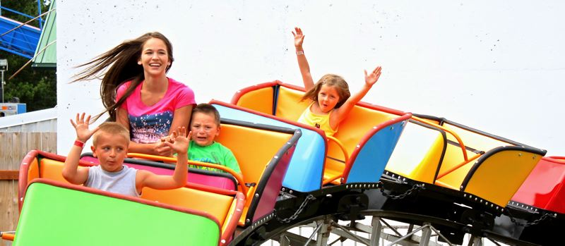 by: POST PHOTO: JIM HART - Kids of all ages loved the mini roller coaster at the carnival during Sandy Mountain Days.