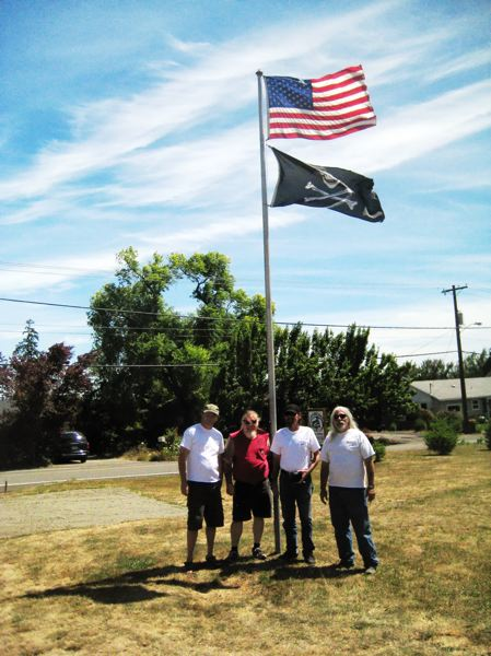 by: COURTESY PHOTOS: JANEL THOMAS - U.S. Navy veteran Bill Wild Bill Ballard (second from left) owns and operates the Iron Horse Garage on Thatcher Road in Forest Grove, where he hosted the first Veterans Day in July fundraiser last summer.