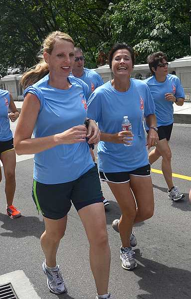 by: VERN UYETAKE - Lake Oswego Assistant to the Police Chief Julia Warren, left, and Citizen Information Specialist Bonnie Hirshberger were among the participants at the annual Special Olympics Torch Run.