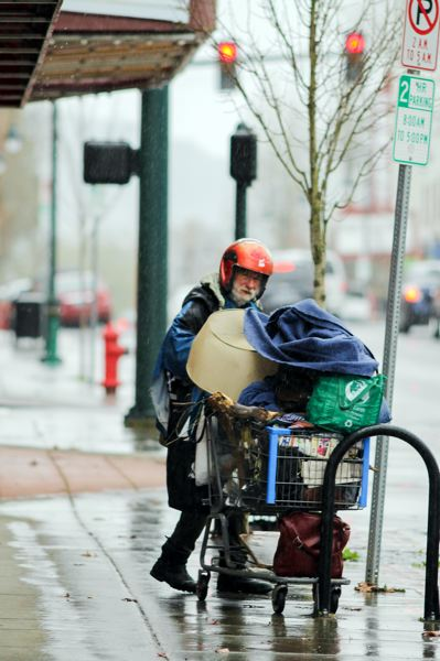 by: NEWS-TIMES PHOTO: JOHN SCHRAG  - 'You've got to know how to weather storms,' says John Wedell, who takes a patient approach to rain: Its Oregon -- itll go away. Sommetimes he adds, 'I'm singing in the rain,' with a cackling laugh, while keeping his eyes down so theyre not stung by big drops.