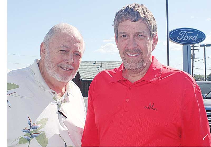 by: HOLLY M. GILL - Terry Hanlon, left, who has owned Miller Ford for 18 years, finalized the sale of his business to longtime Central Oregon car dealers Matt, above, and Bill Thomas, of Bend. The new business name will be Thomas Sales and Service Ford.