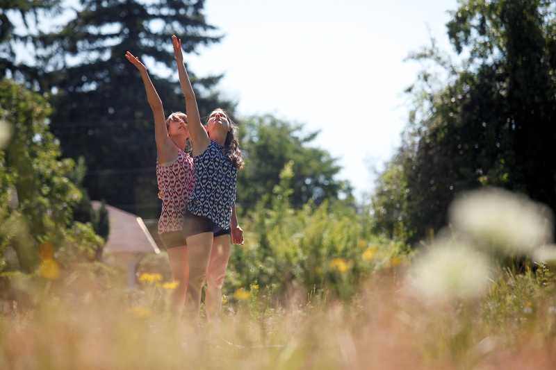 by: TIMES PHOTO: JONATHAN HOUSE - Zahra Banzi-Horn and Tere Mathern perform 'A Drift' at the Ten Tiny Dances event in downtown Beaverton on Saturday.