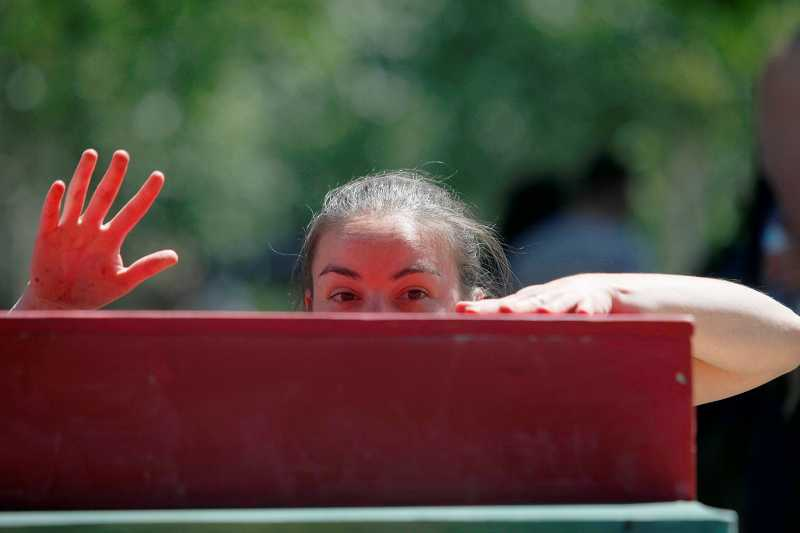 by: TIMES PHOTO: JONATHAN HOUSE - Katrina O'Brien climbs a set of blocks as part of her performance.
