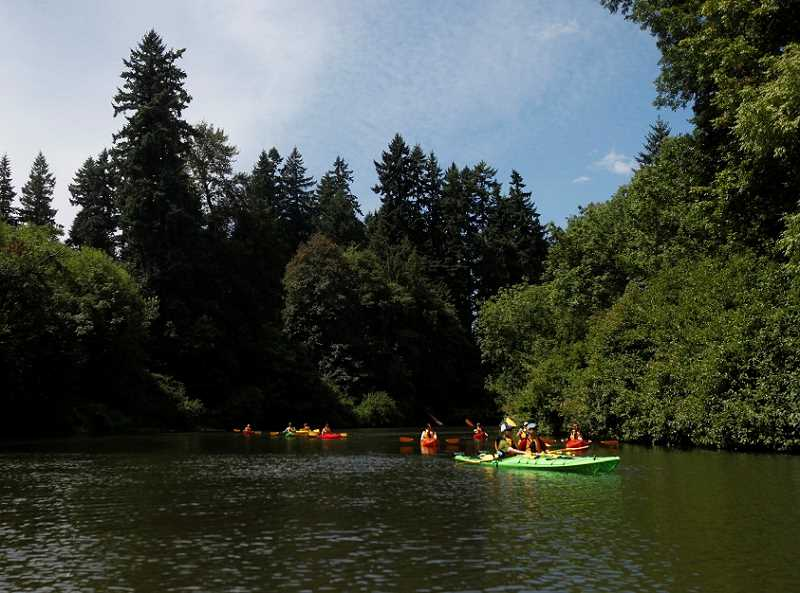 by: JONATHAN HOUSE - An REI kayak class practices in the calm waters of the Tualatin River.