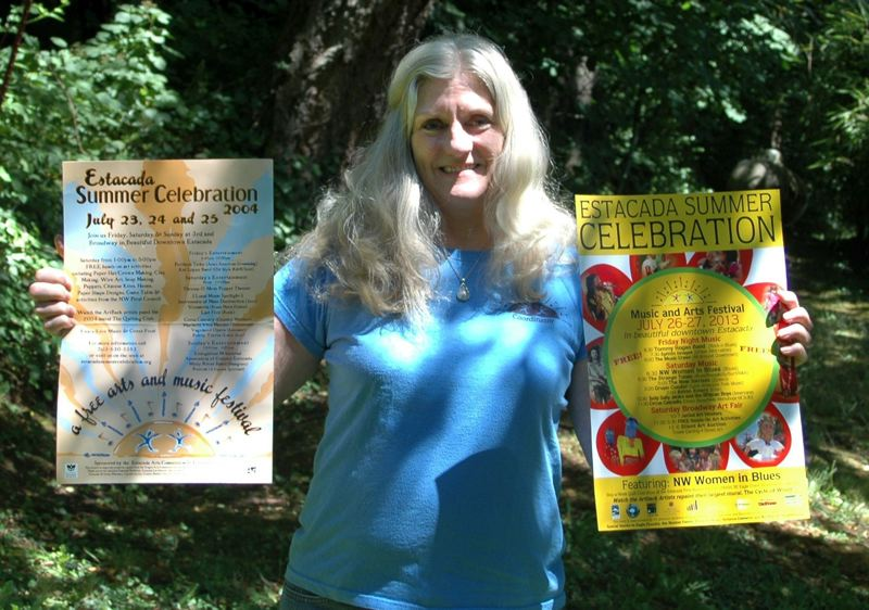 by: ISABEL GAUTSCHI - Jane Reid holds up a poster for the 2004 Estacada Summer Celebration alongside the 2013 poster. The Summer Celebration has been bringing free arts and music activities and entertainment to Estacada for more than a decade.