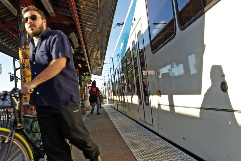 by: TRIBUNE PHOTO BY JAIME VALDEZ - Kevin LaRocca, who has lived in North Portland for two years, steps off a light-rail train near the Killingsworth station.