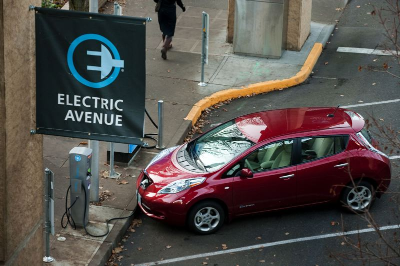 by: TRIBUNE PHOTO CHRIS ONSTOTT - Electric vehicles like this Nissan Leaf can continue recharging at PSU for another year.